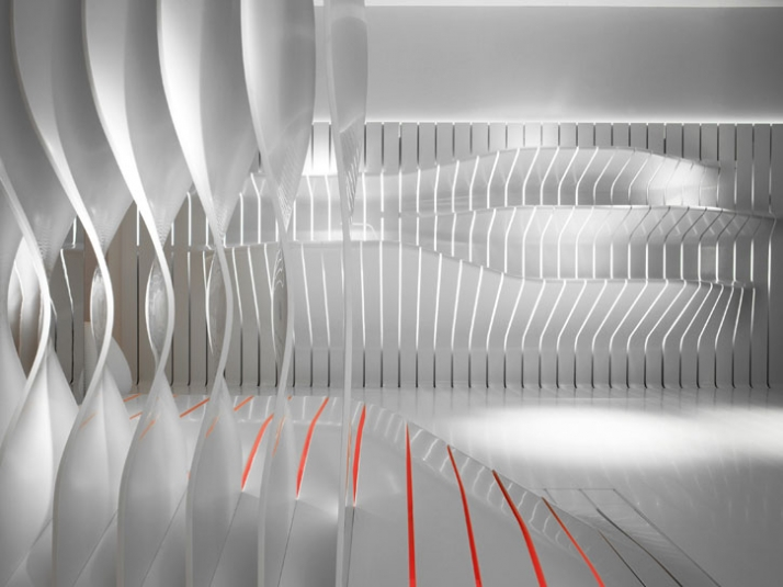 the kitchen area// conceptual kitchen area emerges gracefully from a backdrop of strips  // photo © Leo Torri