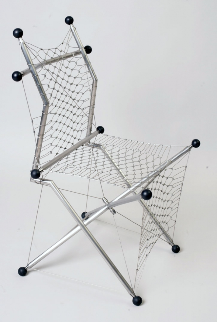 The chair X-tense H 95cm x L 45/45cm. A stainless steel net [web net] has been placed for a comfortable sitting experience.