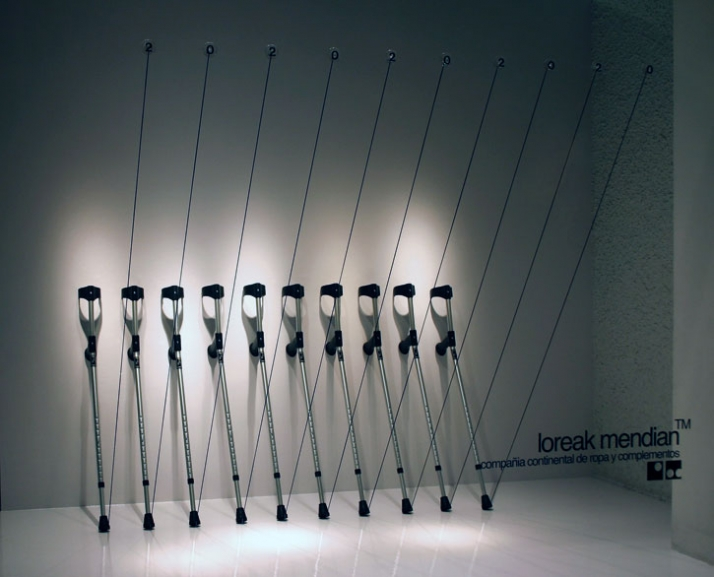 Sale. A Stark row of crutches accentuated with a like number of elasticized black cords. photo by Ion Ander Beloki