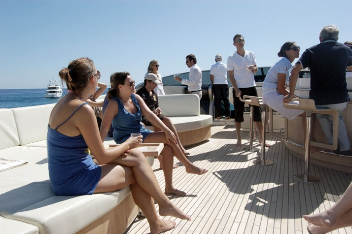 enjoying the sun while enjoying chilled VCP champaigne on the deck of IONA G  //  photo © Yatzer