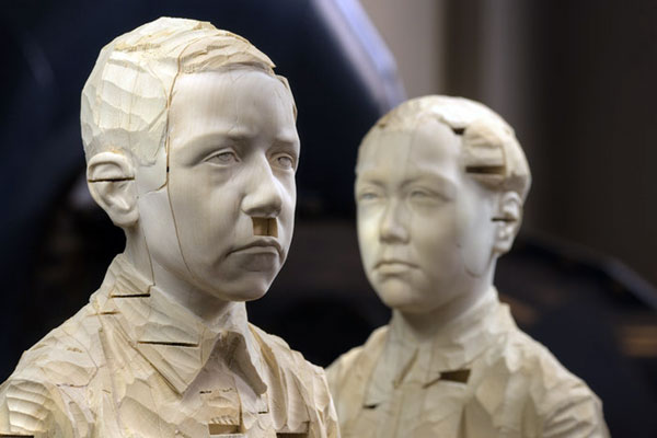 Hitler and Mao, 2007, © Gehard Demetz wood, 2 pieces, ca 168 x 37 x 37 cm each, detail Courtesy Galleria Rubin, Milano Photo by Egon Dejori