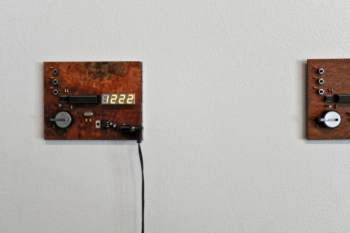 Small wooden clock with exposed circuitry and veneered PCB boards. Created with Marc Beaulieu photo © Varial Studio