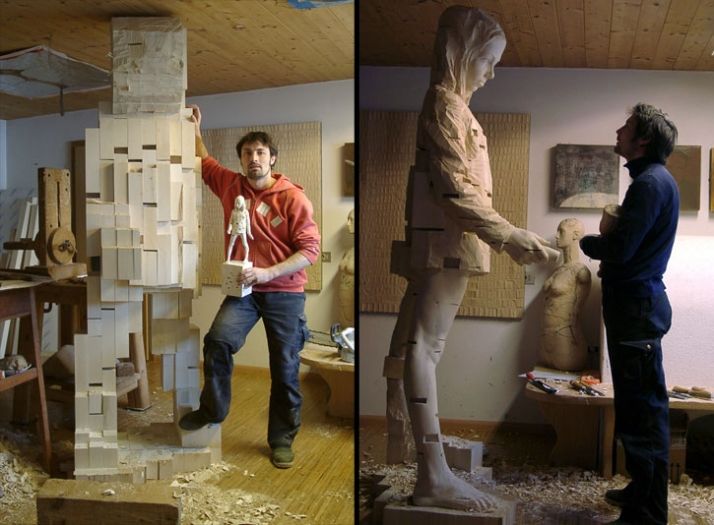 "The artist in his studio with the sculpture:""I want to be flexible"", © Gehard Demetz, 2007, wood, 320 x 79 x 87 cmCourtesy Galleria Rubin, Milano Phot"