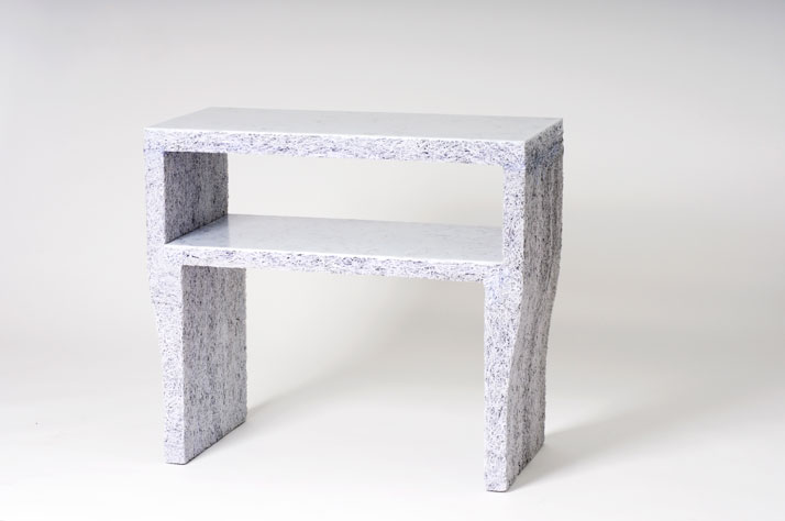 The Shredded Collection Sidetable (White Edition) is made from 6 kg shredded confidential documents and white pigmented resin. The top and inner-shelf