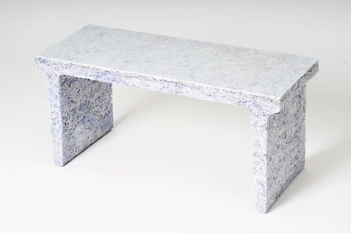 The Shredded Collection Bench (White Edition) is made from 3 kg shredded confidential documents and white pigmented resin. The top and shelves have be
