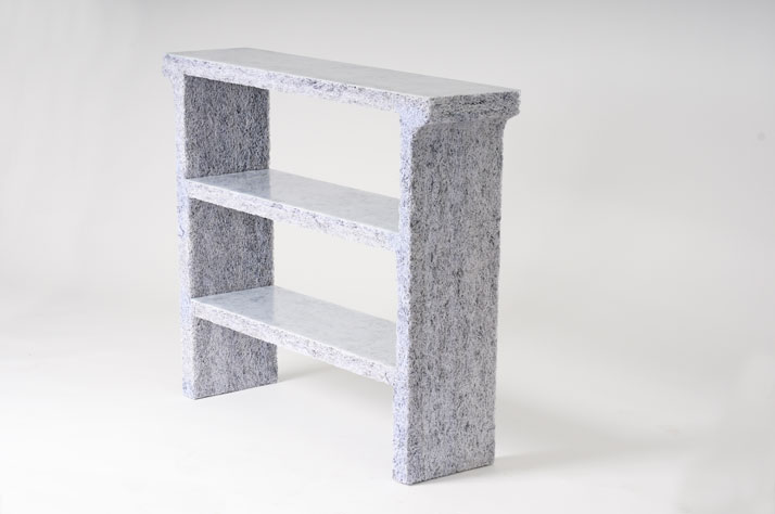 The Shredded Collection Console (White Edition) is made from 5 kg shredded confidential documents and white pigmented resin. The top and shelves have