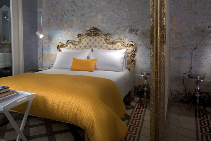 Photo © Brian Grech // Valletta SuitesIn the bedroom:silk Venetian headboard, hand carvedsilk ceiling lamp by the renowned Italian company FlosBespoke