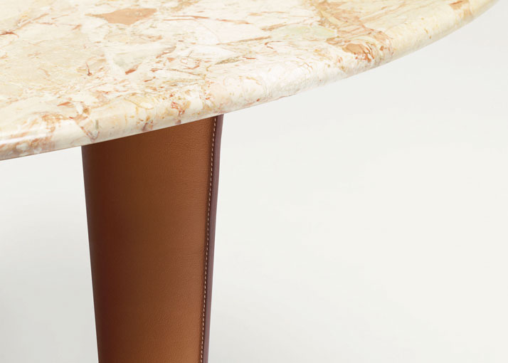 Design: Enzo MariOval table in aurora Breccia marble and gold smooth bull calf, Métiers collectionImage Courtesy of Hermès Paris