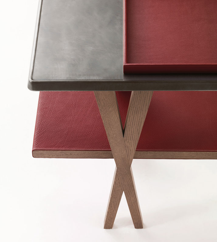Designer: Antonio CitterioConsole in greyed oak, stainless steel with surface patina and H red Clémence bull calf, Matières collectionImage Courtesy o
