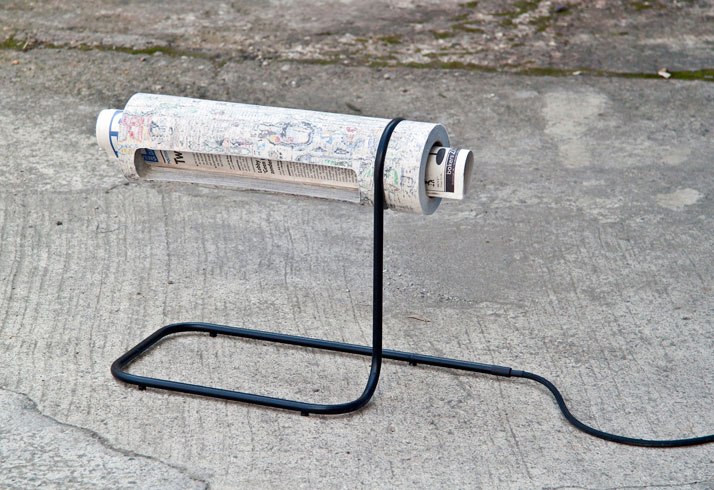Reading Light // NewspaperWood lamp by Christian KocxImage Courtesy of Vij5