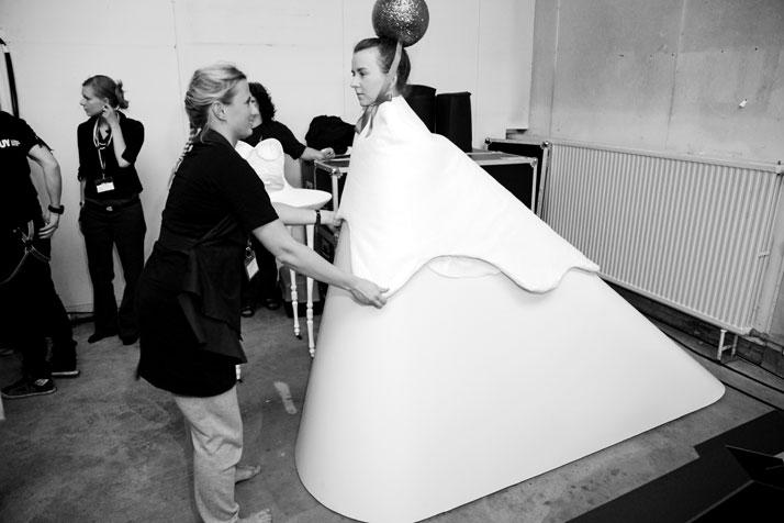 Backstage: Matylda Krzykowski, curator with model Nicole Michniewski in Sue Doeksen's 'Zoethout' dressphoto © Peter Stigter