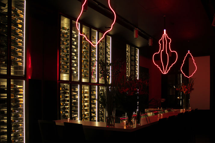 Chandeliers by Jugnet+Clairet in red neon lights in the Atelier.photo © Costas Voyatzis for Yatzer.com
