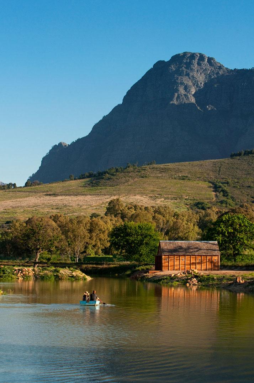 Boating on the farm dam, photo © Babylonstoren