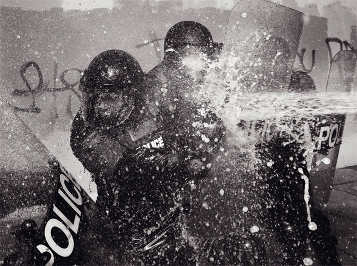 A staged riot in the streets of Brooklyn, photo© Zach GoldImage Courtesy of Gestalten