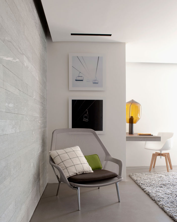 ARMCHAIR: Slow chair, Bouroullec for Vitra. DESK LIGHT: Lighthouse, Bouroullec for Established & Sons.OFFICE CHAIR: Flow armchair, J.M Massaud for