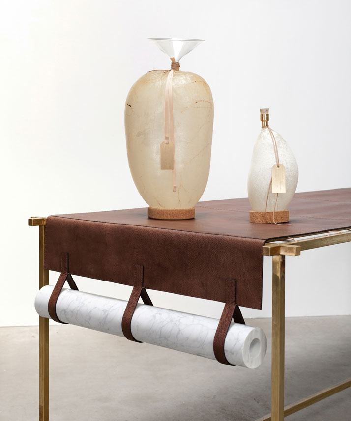 Water containers: Cow bladders, glass, brass, corkLeather table (detail): Discarded Fendi leather, brass structure, marble weights Photo © Luisa Zanza