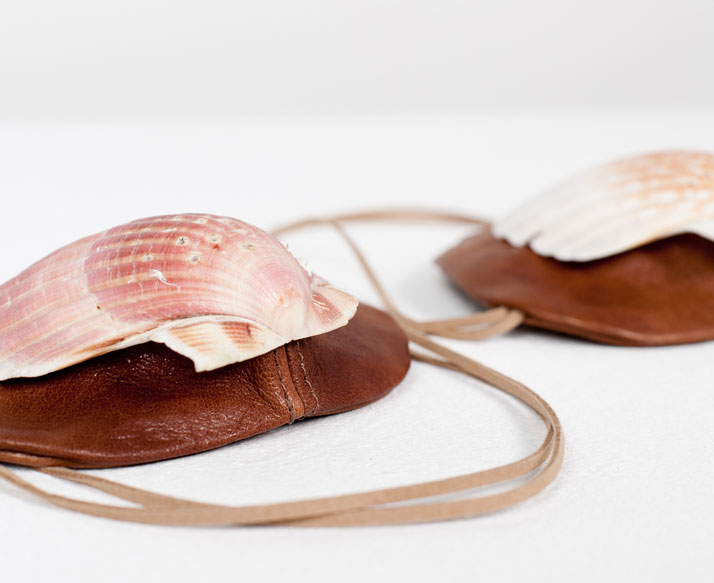 Protective masks: Discarded Fendi leather, scallop-shellsPhoto © Luisa Zanzani