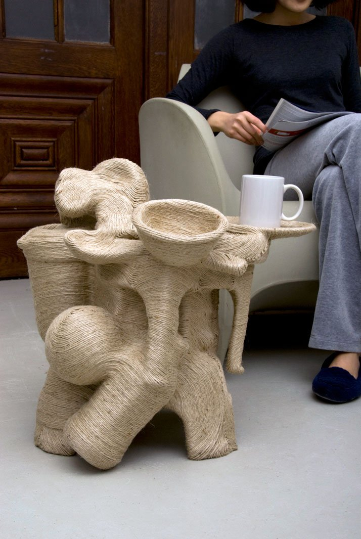 "Jute Side Table / Jute (Plant Fiber), 12 mundane plastic objects / 21""x 20.5""x 21""  photo © Jay Sae Jung Oh"