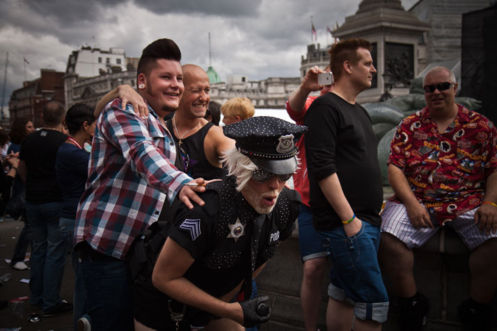 July  2012 // Men pass through the WorldPride 2012 celebration in Trafalgar  Square after the WorldPride march in which an estimated 25,000 people  to