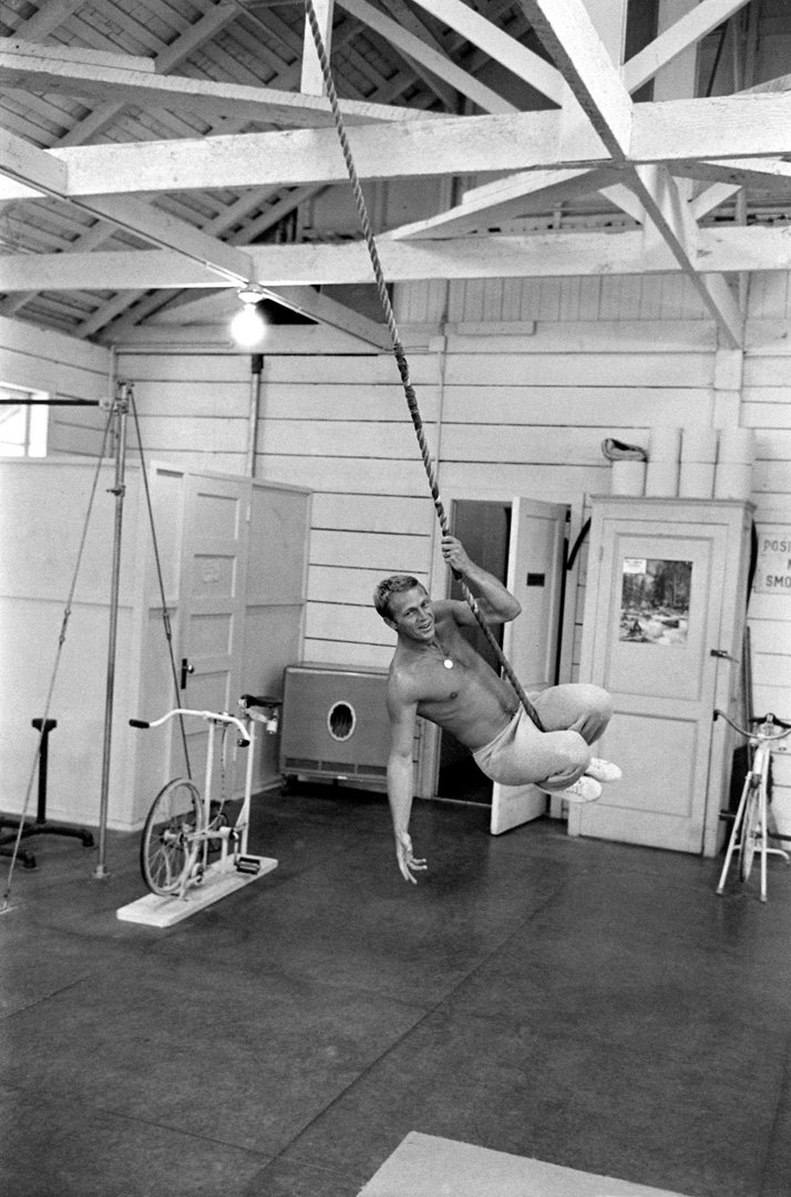 Steve McQueen: KING OF COOLSteve McQueen swinging from rope in his gym, CA, 1963photo © John Dominis / Time Inc. All Rights Reserved.
