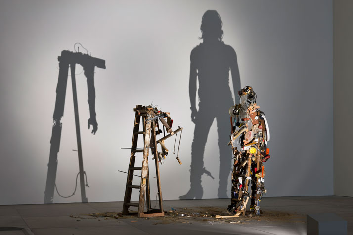 Nasty Pieces of Work 2008-2009Two wooden stepladders, discarded wood, broken tools, light projector2 parts: 171 x 166 x 86 cm (67⅜ x 65⅜ x 33⅞ i