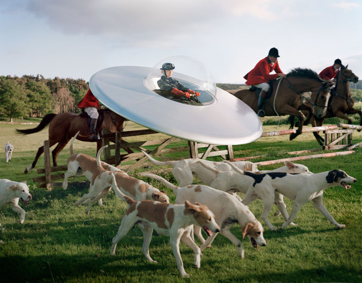 Kinga Rajzak in flying saucer with members of the West Percy HuntEglingham Hall, Northumberland, 2009photo © Tim Walker