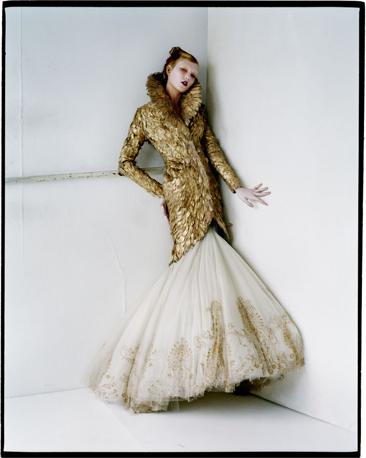 Karlie Kloss in gold feathersShoreditch, London, 2010photo © Tim Walker