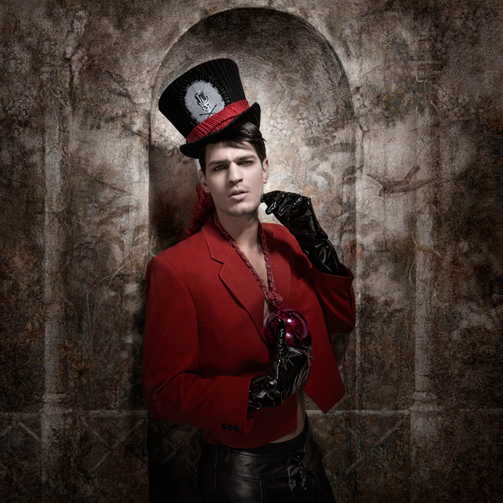 The magicianRed ball with flower inside Necklace: Pericles Kondylatos / Model: Jimmy (VN Models) / Top hat: Mad Dollies Rag house / Gloves: Kostadinos Melis by Laskos / Costume: vintage from private collection / Leather trousers: Kostadinos Melis by Laskos / Scarf on the top hat: Dafni Valente / Hair styling: Nicolas Balalios / Make-up: Make-up lab team: Yiannis Marketakis , Christina Ermidis, Giorgos Fytas / Photo: Sylwia Makris / Styling: Pericles Kondylatos