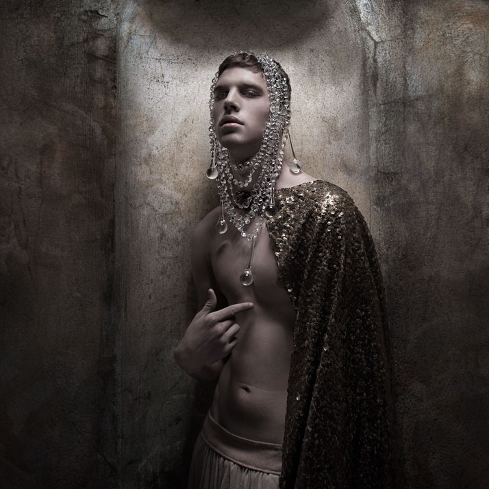 The boy KingCrystal   Necklace worn as a headpiece: Pericles Kondylatos / Model: Yarric (VN   Models) / Top worn as a cape: Kostadinos Melis by Laskos / Skirt:   celebrity skin / Make-up: Giorgos Fytas for make-up lab / Hair: Nicolas   Balalios / Photo: Sylwia Makris / Styling: Pericles Kondylatos