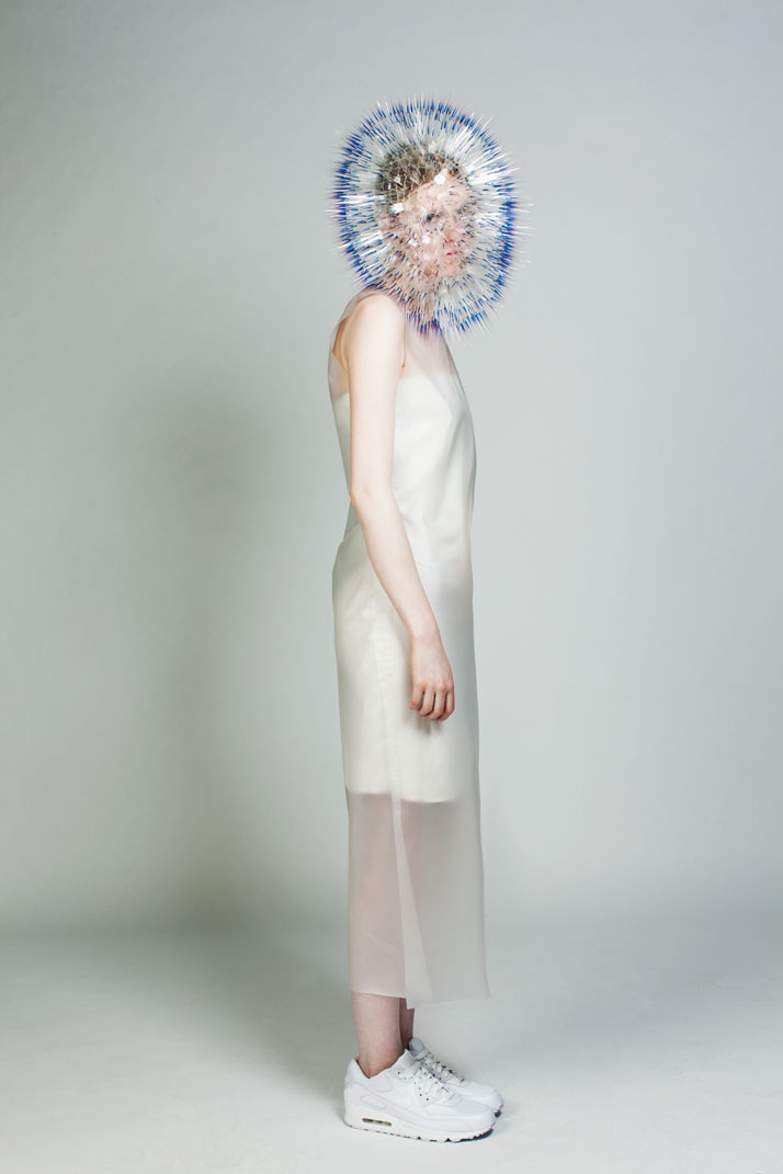 LOOK1: CLEAR FILM, PERSPEX, SILVER.Atmospheric Reentry, MA final Collection, © Maiko Takeda, 2013.Art Direction: Samuel John Weeks, Model: Victoria Savory (STORM), Makeup: Carol Morley, Photographer: Bryan Huynh.(Garment collaboration with Louise Bennetts).