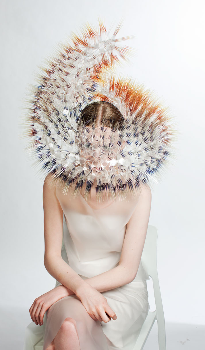 LOOK7: CLEAR FILM, PERSPEX, SILVER.Atmospheric Reentry, MA final Collection, © Maiko Takeda, 2013.Art Direction: Samuel John Weeks, Model: Victoria Savory (STORM), Makeup: Carol Morley, Photographer: Bryan Huynh.(Garment collaboration with Louise Bennetts).