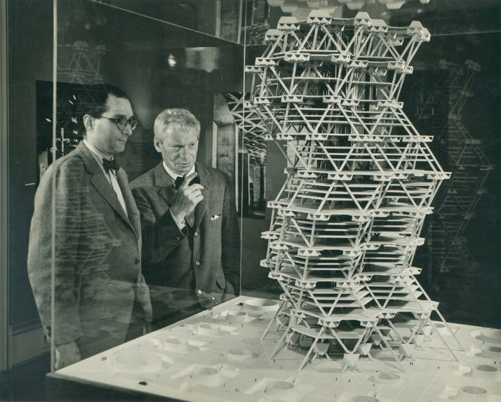Louis  Kahn in front of a model of the City Tower Project in an exhibition at  Cornell University, Ithaca, New York, February 1958.© Sue Ann Kahn.