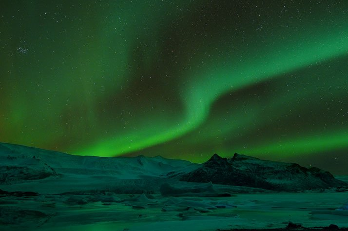 Aurora Borealis as seen from Fjallsárlón glacial lagoon, Iceland. photo © David Wilkie and Paula Costello.