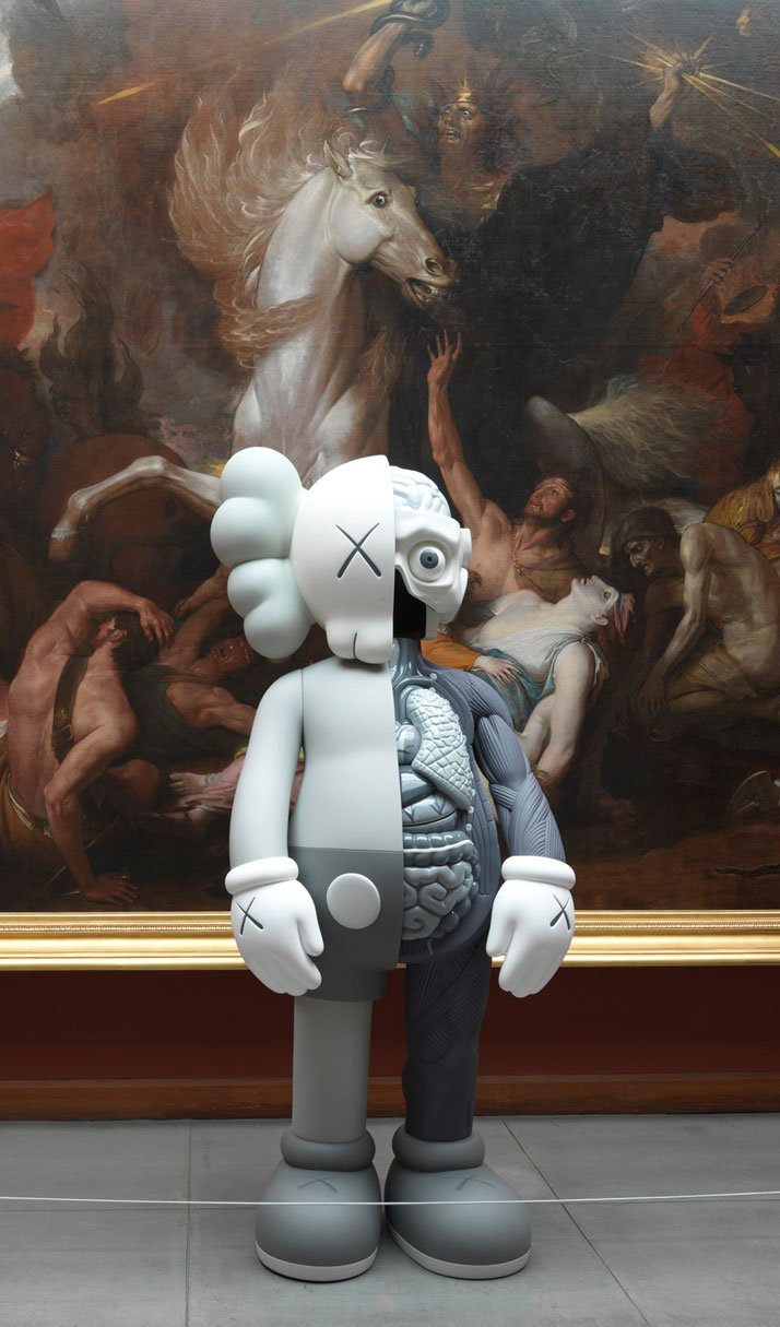 KAWS, COMPANION (ORIGINALFAKE), 2011Fiberglass and rubberized paint; grey colorway; 96 x 48 x 36 inchesInstallation view at the Pennsylvania Academy of the Fine Arts, 2013. Image courtesy of PAFA.