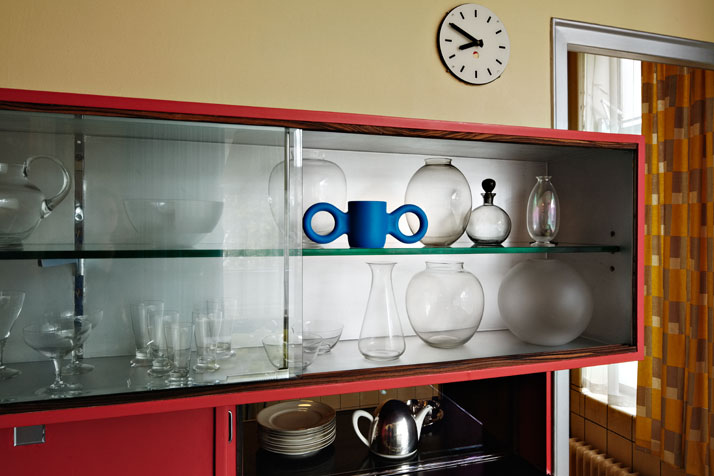 Sonneveld House Dining room. Cupboard with glassware by  design of A. D. Copier, and a 'Domoor' mug designed by Richard Hutten.  Photo by Johannes Sch