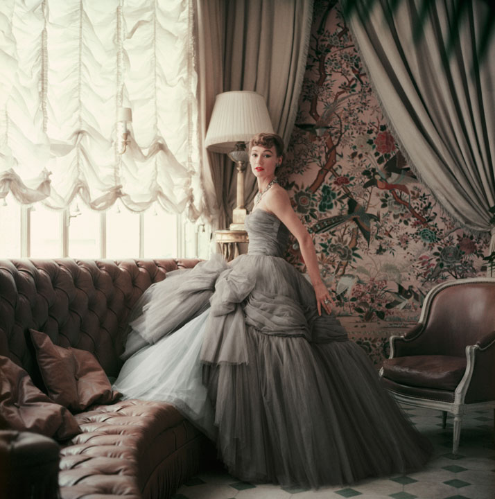 Sophie Malgat -  the wife of the film director Anatole 'Tola' Litvak—was one of the rare  models who starred on the catwalk and had ''cover girl'' status in  magazine editorials. ''Sophie knew how to move in clothes and how to  pose,'' says Brigitte Tortet. ''She defined truly elegant.'' Shaw  photographed her in the Jardin d'Hiver of Christian Dior's hôtel  particulier on boulevard Jules Sandeau in Paris's 16th arrondissement.1953, Evening dress, Autumn-Winter 1953 Haute Couture collection, Vivante line.photo © Mark Shaw.
