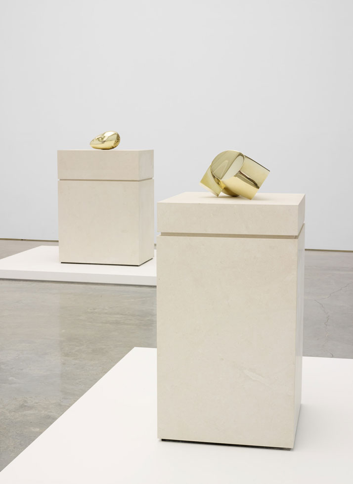 Constantin  Brancusi. From left to right: Sleeping Muse II and Head. Installation  view at Paul Kasmin Gallery during the exhibition ''Brancusi in New York  1913–2013''. Courtesy of the Brancusi Estate and Paul Kasmin Gallery.