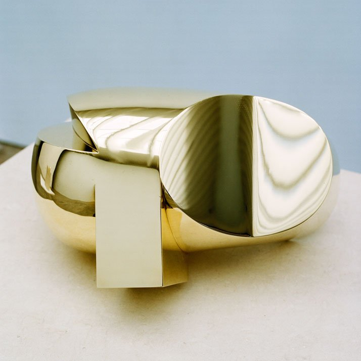 Constantin Brancusi, Tete, 1920-1992, polished bronze, 7 1/2 x 9 1/2 x 11 3/4 inches, edition of5. Photography by Francois Halard/© Artists Rights Society (ARS) New York/ADAGP, Paris. / Courtesy of the Brancusi Estate and Paul Kasmin Gallery.{Head (circa 1920), made from polished bronze and measuring 7.5 by 9.5 by 11.75 inches in an edition of 5, illustrates how, in the words of Eugene Ionesco, ''[Brancusi] had assimilated the entire history of sculpture, mastered it, gone beyond it, rejected it, come back to it, purified it, reinvented it. He had got it down to its essence.'' With Head, Brancusi's inquiry into the totemic nature of masks resulted in an interpretation that encapsulated his most complete geometric abstraction.}