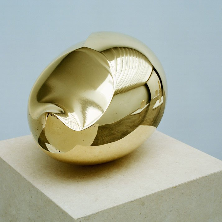 Constantin Brancusi, Le Nouveau Né I, 1920-2003, polished bronze, 5 3/4 x 5 1/2 x 8 1/2 inches, edition of 8. Photography by Harald Gottschalk /© Artists Rights Society (ARS) New York/ADAGP, Paris. / Courtesy of the Brancusi Estate and Paul Kasmin Gallery.{''We do not see real life except by its reflection,'' wrote Brancusi in 1919, and with The Newborn (1920) Brancusi created his most radically abstract sculpture representing not only the act of birth but also the newborn baby. Previously Brancusi named it Beginning of the World, referencing the violence with which human life begins. But Brancusi tempers this association with the smooth lines of the sculpture, bringing serenity into the subject matter.}