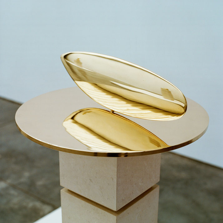 Constantin Brancusi, Le Poisson, 1926-1992, polished bronze, 5 3/4 inches high x 17 3/4 inches in diameter, edition of 8. Photography by Francois Halard/© Artists Rights Society (ARS) New York/ADAGP, Paris. / Courtesy of the Brancusi Estate and Paul Kasmin Gallery.{With Fish (1926), the artist advances his study of sculpture into a moving artwork. Fish, a polished bronze sculpture measuring 5.3 x 16.5 x 1.2 inches in an edition of 8, rotates on its disc allowing the sculpture to mimic the movement and spirit of its subject. Fish was born out of Brancusi's goal to capture a creature's movement, one he worked obsessively towards.}