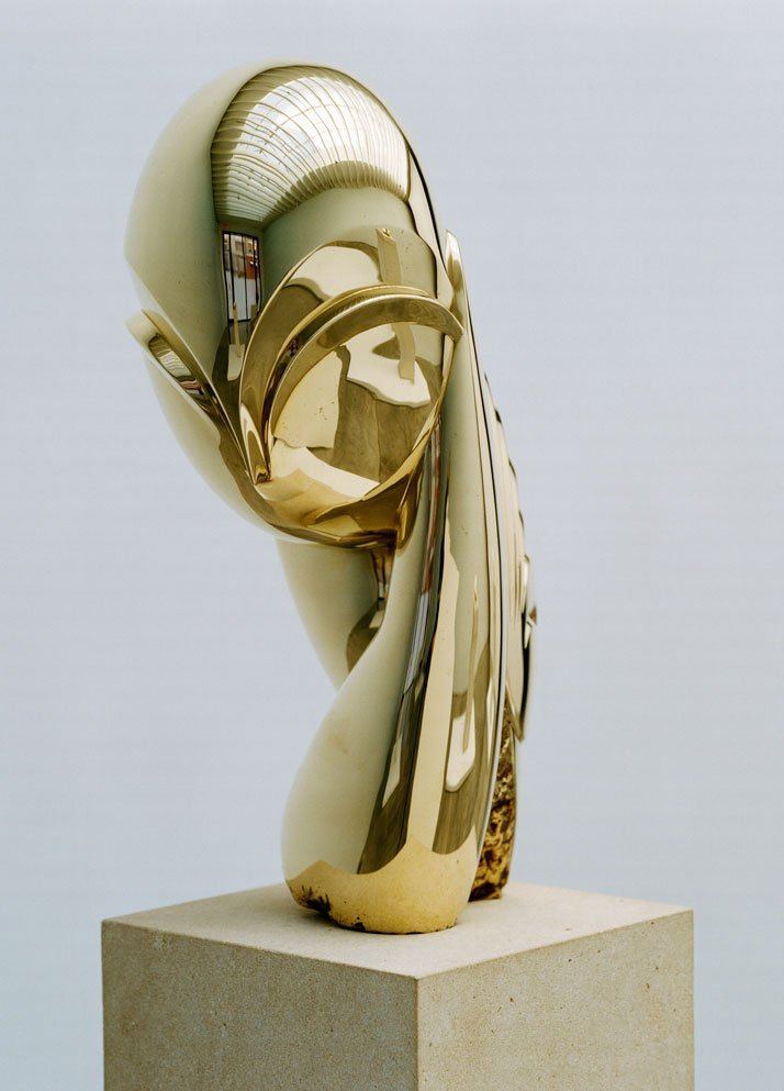 Constantin Brancusi, Mademoiselle Pogany II, 1925-2006, polished bronze, Sculpture: 16 7/8 x 7 x 11 3/4 inches, Overall: 27 x 10 x 8 3/4 inches, edition of 8. Photography by Francois Halard/© Artists Rights Society (ARS) New York/ADAGP, Paris. / Courtesy of the Brancusi Estate and Paul Kasmin Gallery.{Mademoiselle Pogany II (1925), stands at 11.7 inches tall, in an edition of 8. The plaster model of the first version debuted at the Armory Show in 1913. The series of Mademoiselle Pogany was his most photographed work. Today this polished bronze version of Mademoiselle Pogany II still embodies the inexpressible nature of the feminine spirit.}