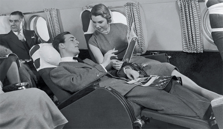 Relaxing in a first-class 'Slumberette' on board a Lockheed Constellation, early 1950s.Airline: Style at 30,000 Feet (mini edition). Courtesy of Laurence King Publishing.