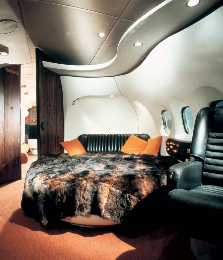 The interior of the private DC-9 as decked out for Playboy's chief, Hugh Hefner. He took delivery of the jet from aircraft manufacturer McDonnell Douglas in January 1970 and dubbed the aircraft 'Big Bunny'. Black leather abounded, as did the unashamed use of animal pelts for the bed spread.Airline: Style at 30,000 Feet (mini edition). Courtesy of Laurence King Publishing.