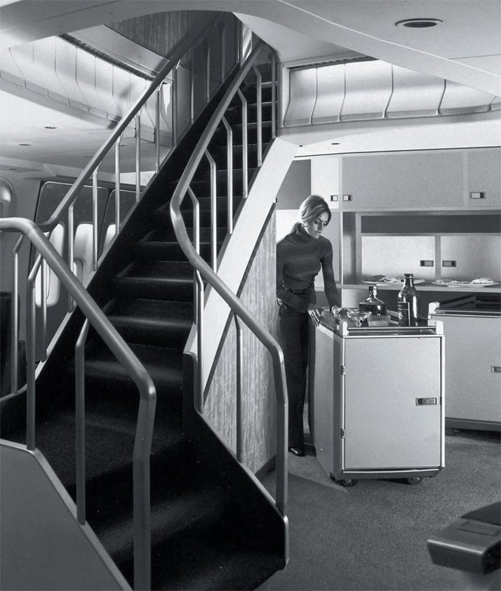 Stairway  to heaven: in the days before fuel crises and subsequent policies of  maximising passenger count per square metre, the upper deck of the  Boeing 747 housed a cocktail lounge, while space under the stairs served  as a drinks cabinet,1970.Airline: Style at 30,000 Feet (mini edition). Courtesy of Laurence King Publishing.