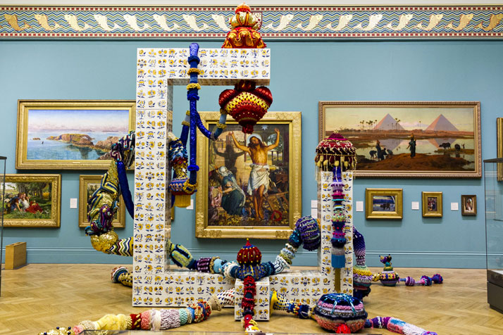 Joana Vasconcelos, Cottonopolis, 2014.Viúva Lamego hand painted tiles, handmade woollen crochet, ornaments, polyester, MDF, iron.425 x 625 x 490 cmCollection of the artist2014 Time Machine, Manchester Art Gallery, Manchester.photo © Joana Vasconcelos.
