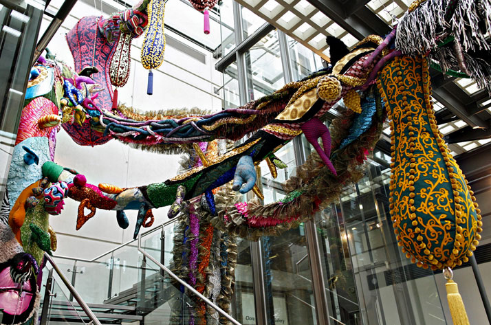 Joana Vasconcelos, Britannia, 2014.Handmade woollen crochet, felt appliqués, fabrics, ornaments, polystyrene, polyester, steel cables. Dimensions variableCollection of the artist.2014 Time Machine, Manchester Art Gallery, Manchester.photo © Joana Vasconcelos.