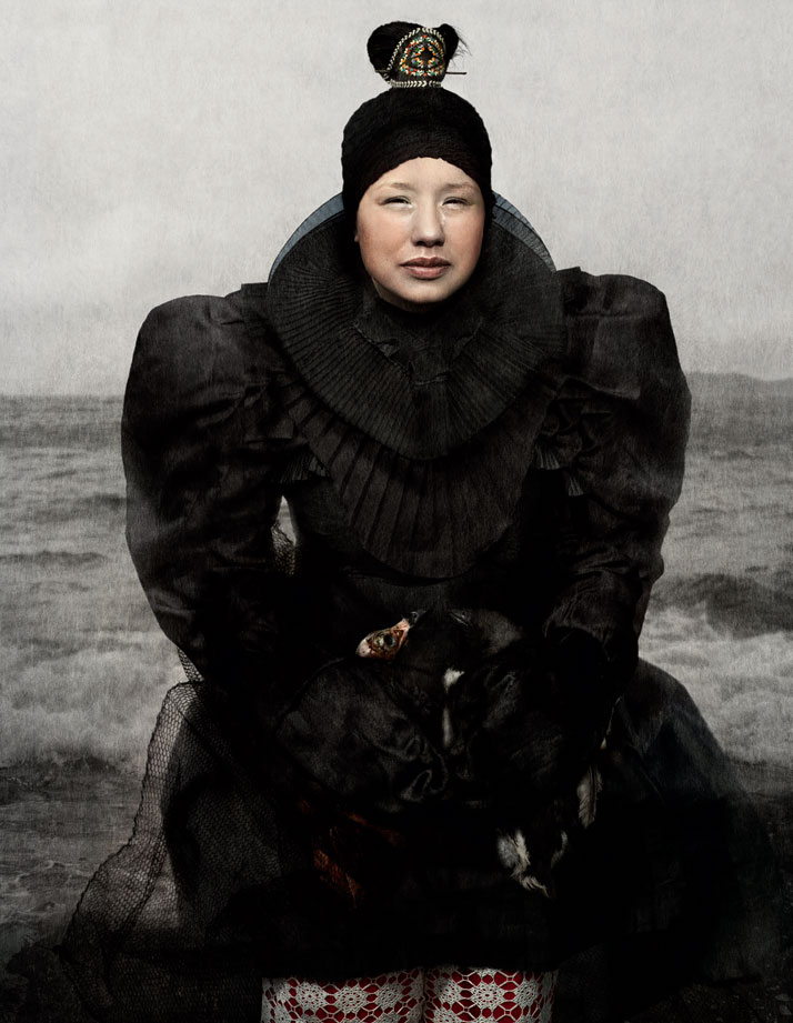 Najannguaq Lennert, Malu at the Nuup Kangerlua Fjord Holding two Spit Skinned Birds.By  Cooper & Gorfer from The Weather Diaries, Nordic Fashion Biennale,  copyright The Nordic House, Iceland & SEEK 2014. Image courtesy of  Gestalten.
