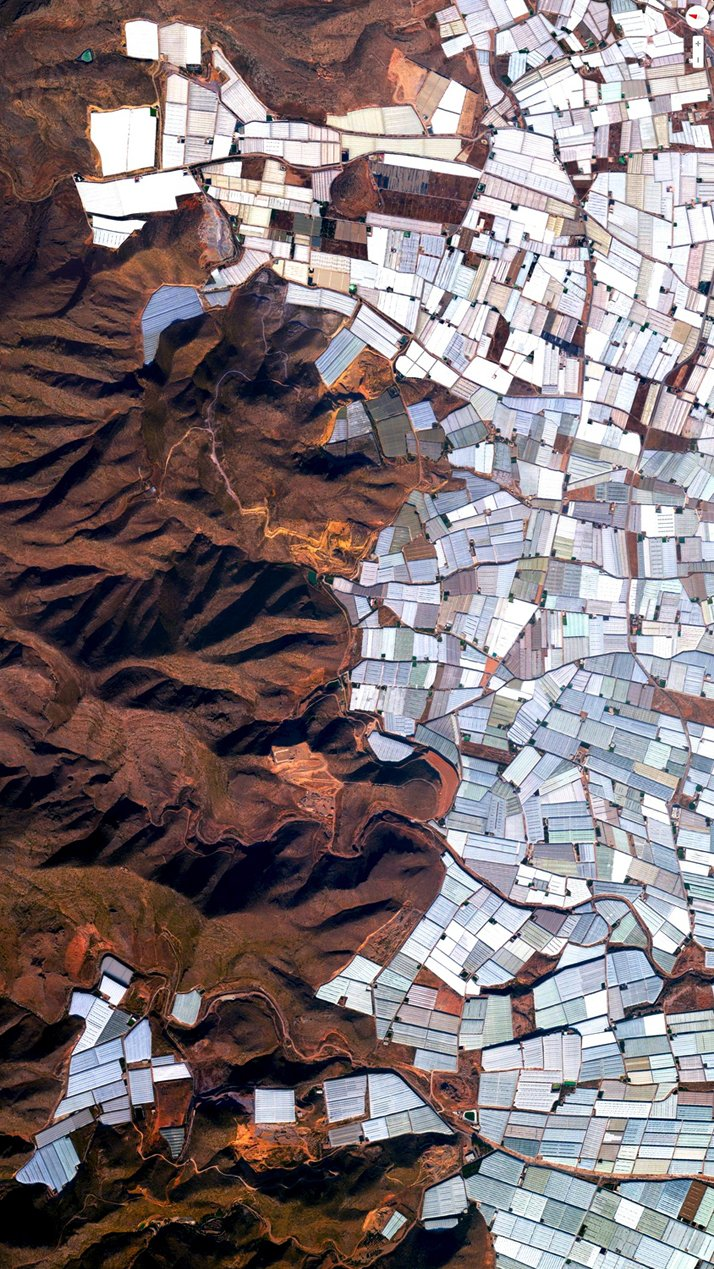 Plasticulture / Greenhouses, Almeria, Spain.Overview captured with Apple Maps. Satellite imagery from Digital Globe.Copyright 2014, Daily Overview.
