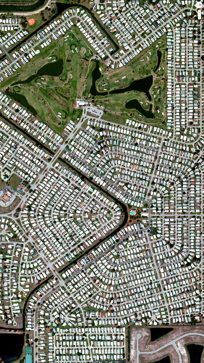 Barefoot Bay Development, Brevard County, Florida, USA.Overview captured with Apple Maps. Satellite imagery from Digital Globe.Copyright 2014, Daily Overview.