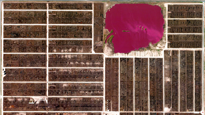 Cattle feedlots and waste lagoon, Summerfield, Texas, USA.Overview captured with Apple Maps. Satellite imagery from Digital Globe.Copyright 2014, Daily Overview.
